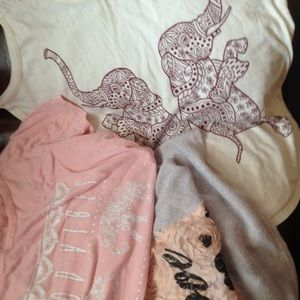 Bundle of two tank tops and short sleeve shirt.